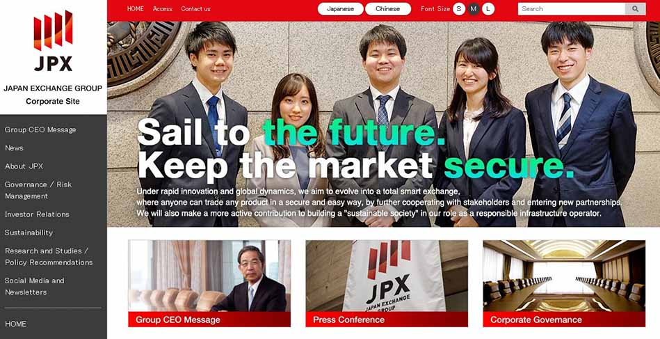 Zu sehen sind mehrere japanische Börsenfachleute. Sie sind jung und lächeln den Betrachter an.